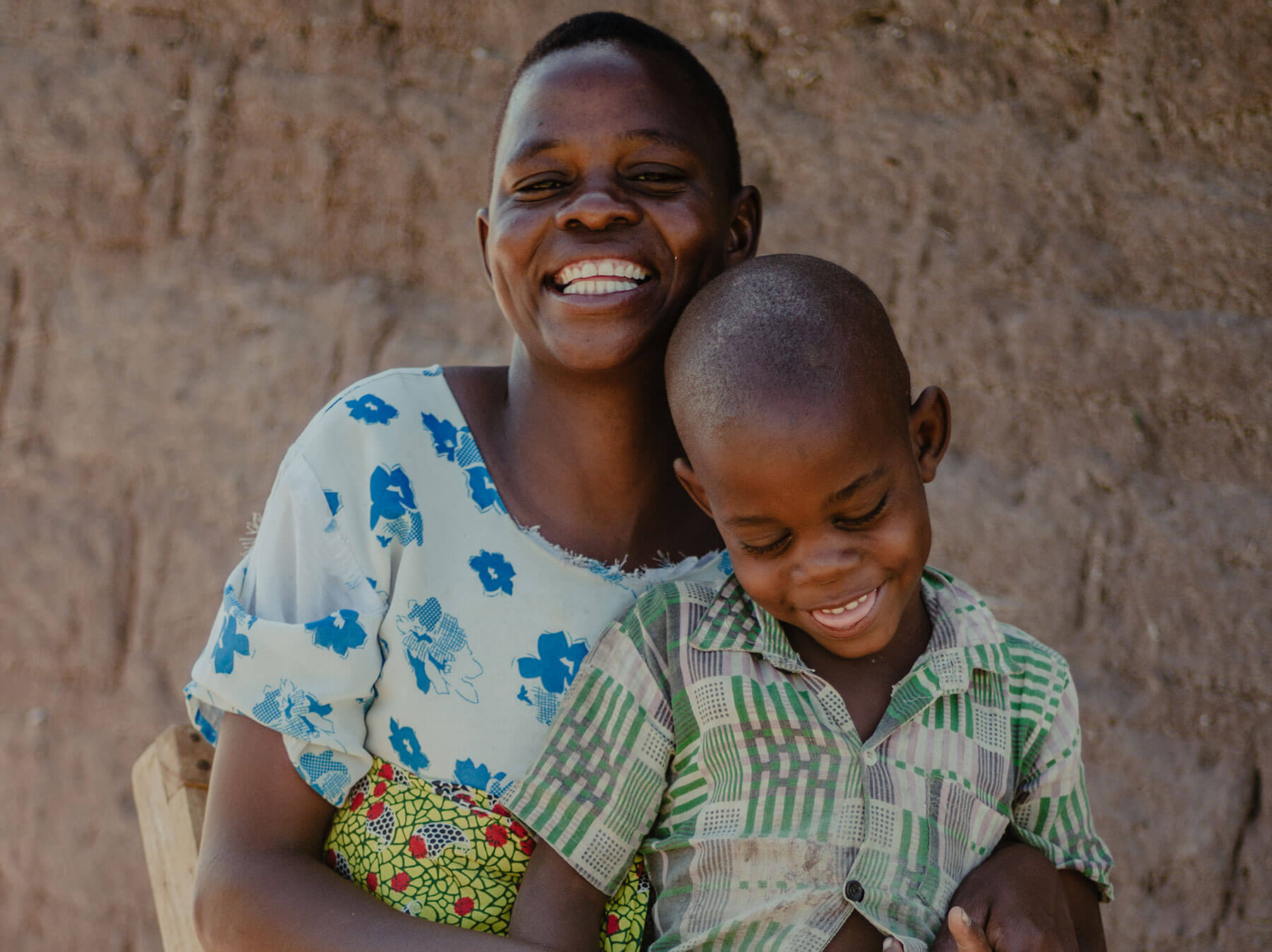 woman with child smiling
