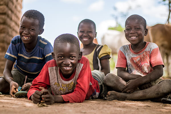 children playing and smiling on the ground