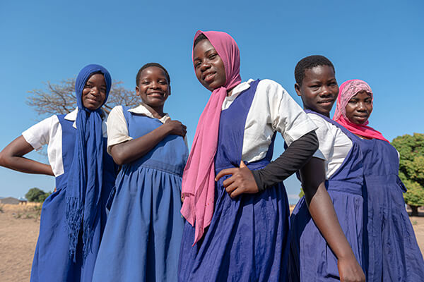 African women smiling in uniforms