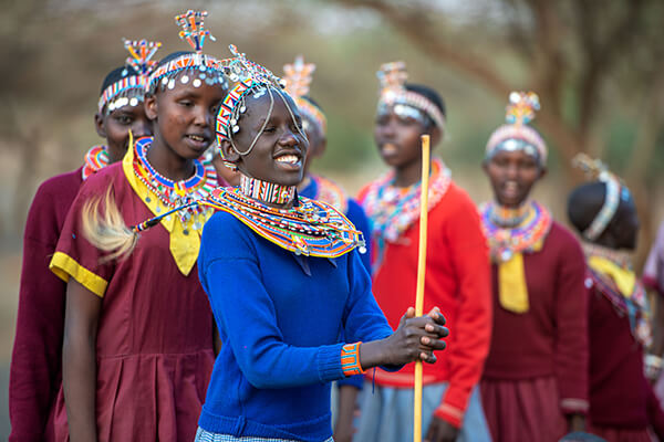 Afrian women smiling and dressed up