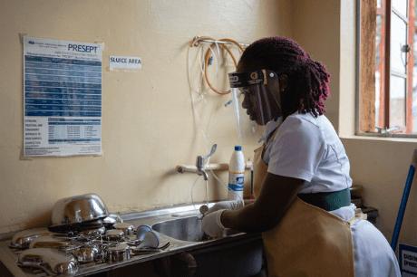 a-nurse-in-uganda-sterlizes-medical-equipment