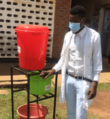 health-worker-in-malawi-with-buckets-of-water