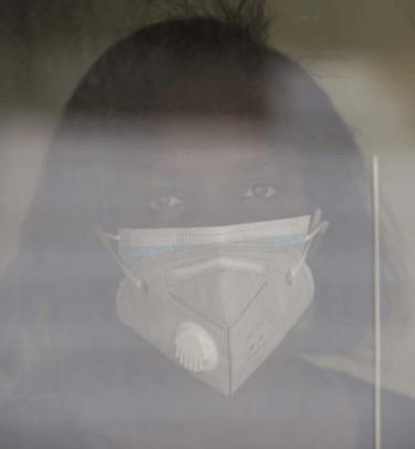 Fridah Kagwiria Kibiti, a nurse working at Nairobi Metropolitan Services wearing two masks